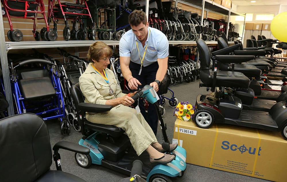 Ableworld staff member helping customer in retail store