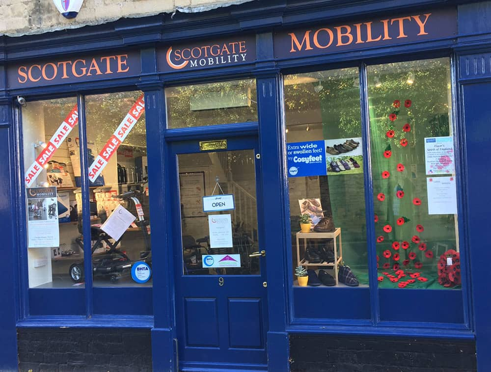 Retailer uses shop window visual appeal to support poppy appeal