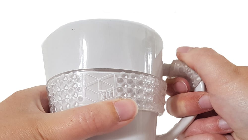 Handygrip wrapped around a cup