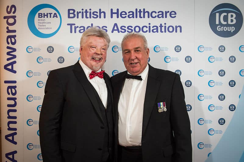 BHTA Annual Awards night Simon Weston CBE and another gentleman posing