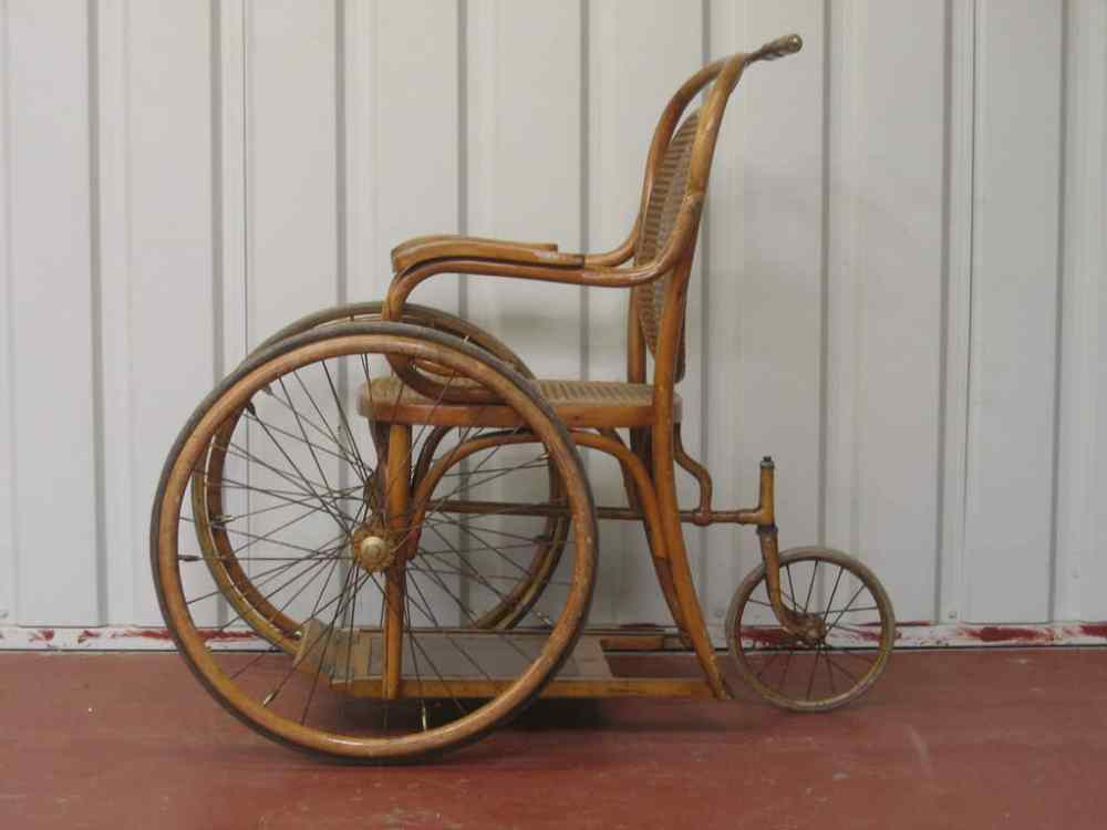 Old wheelchair made from wood