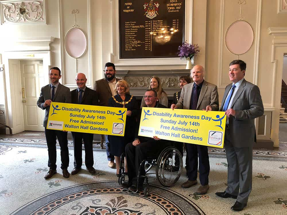 Disability Awareness Day sponsors in Town Hall Warrington with Mayor and Warrington Disability Partnerships's Dave Thompson