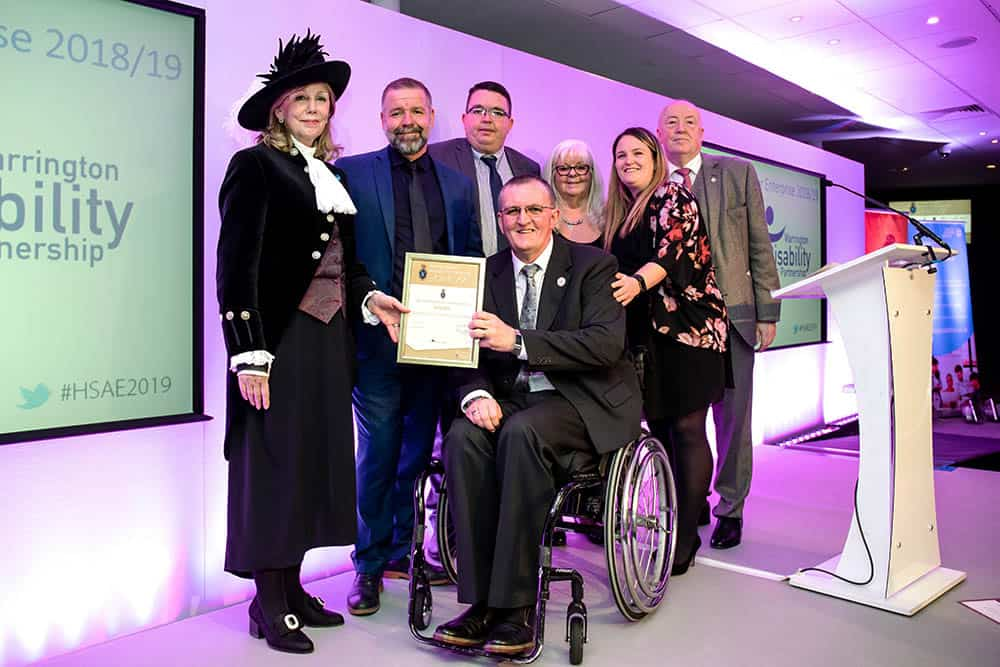 Warrington Disability Partnership team and Dave Thompson at award April 2019