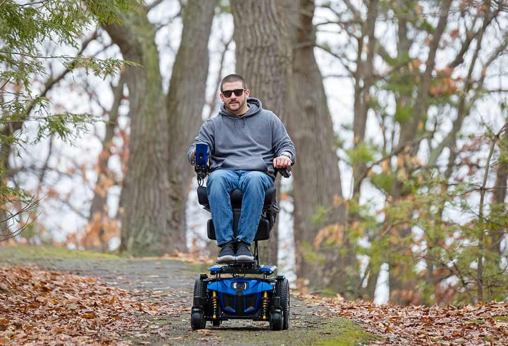 Quantum Edge 3 powerchair being ridden in the woods