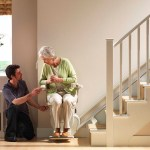 Stanah stairlift being used by woman in the home