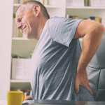Man with Arthritis in pain on chair