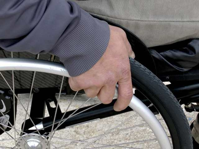 Wheelchair with man hand forPersonal Health Budgets