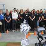 TGA Mobility EAD Team together by mobility scooter test track