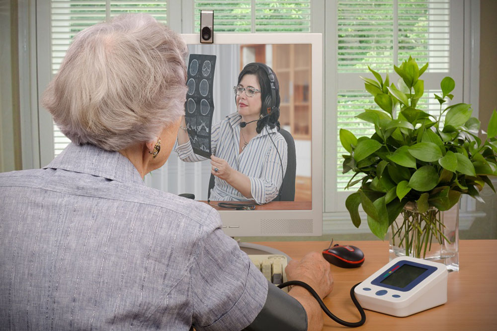 Ageing Society old woman using telecare innovation to champion growth