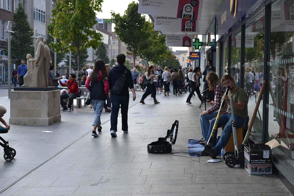 UK High Street with buskers playing music