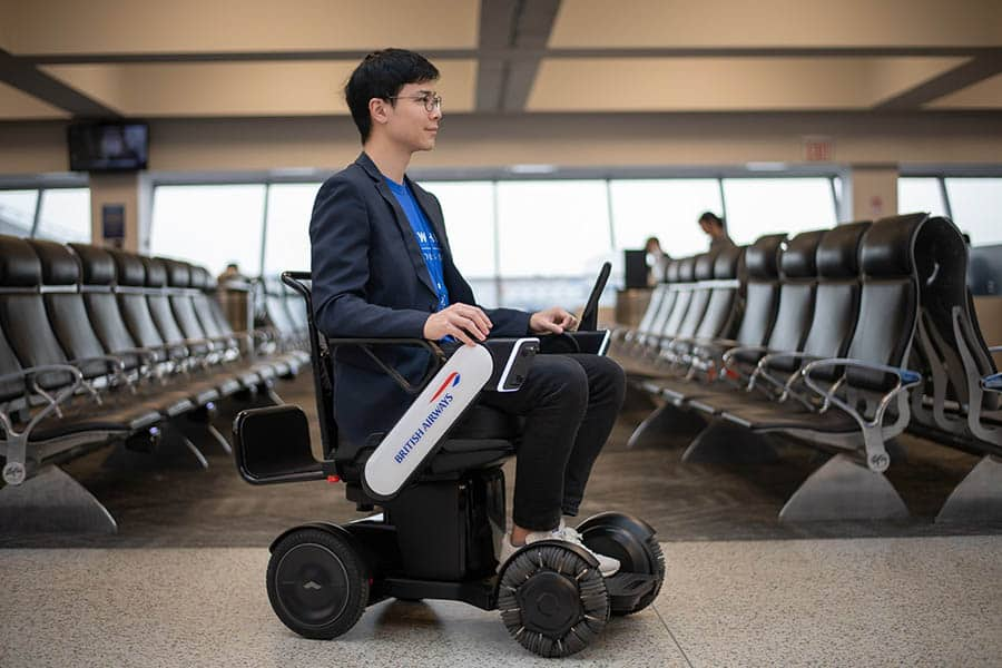 British Airways WHILL powerchair with man