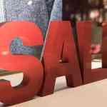 sale in shop window sign