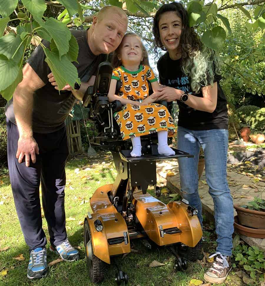 Lily and family with Piccolino powerchair and K110 featured