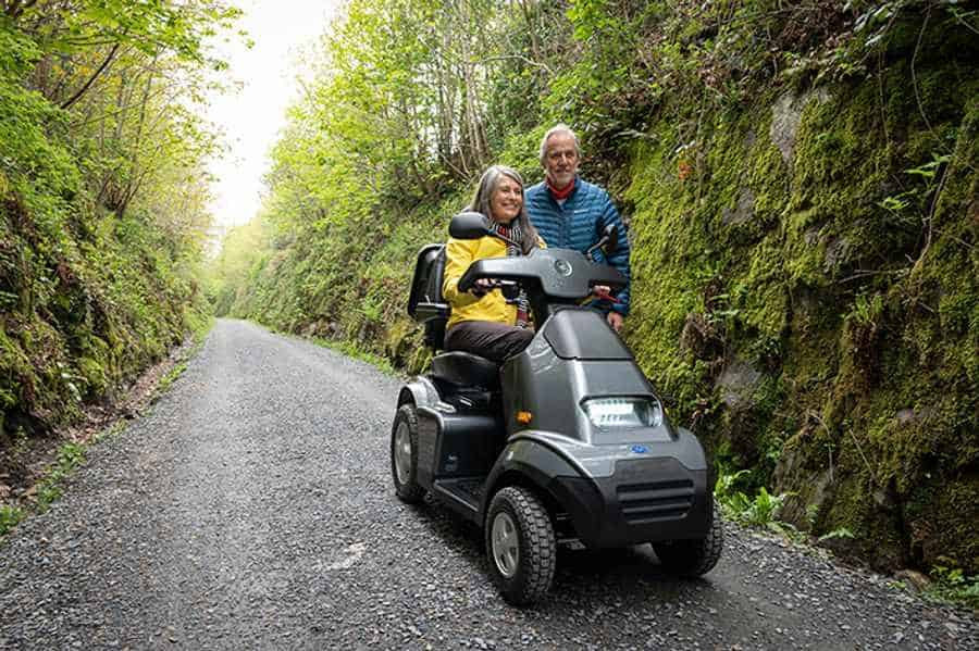 Visitors to the Lake District National Park enjoying the many accessible routes on a suitable TGA mobility scooter.
