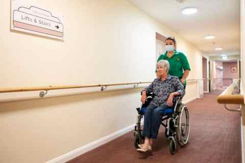 Wheelchair user and carer credit Tunstall Healthcare