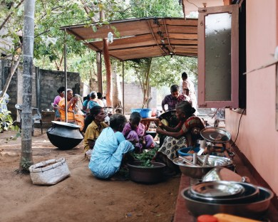 the cooking area on the other side of our house. In giant pots the food is being prepared for the funeral attendees.