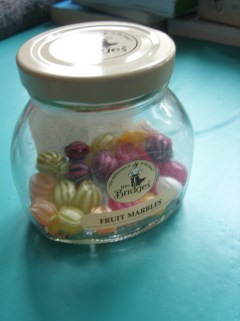 Jar of fruit marbles that never quite made it into my sisters stocking last Christmas. It has however aided my through several sewing tribulations.