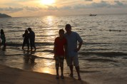 Dad and daughter in the sunset