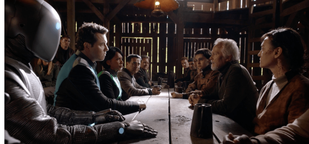 The Orville away team meets at a table with members of the Reformers.