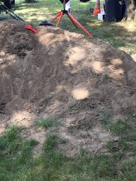 big pile of dirt at construction birthday party for kid activity to keep toddlers busy
