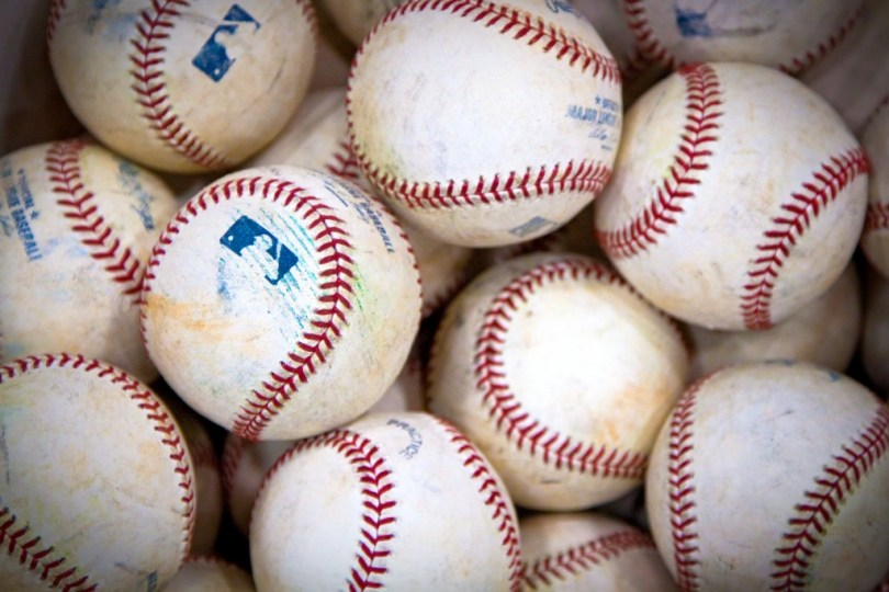 """My job at the All-Star Game was to handout gift laptops to the players courtesy of my employer Dell.   I was stationed at the """"signing room"""" which in the case of the National League was in an underground batting cage off the locker room.   This is a photos of a bucket of well-used battinr practice baseballs."""