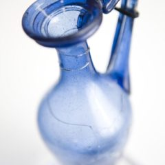 Roman blue glass jug with ornate handle