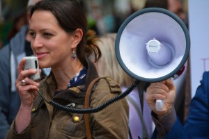 Woman speaking with a megaphone