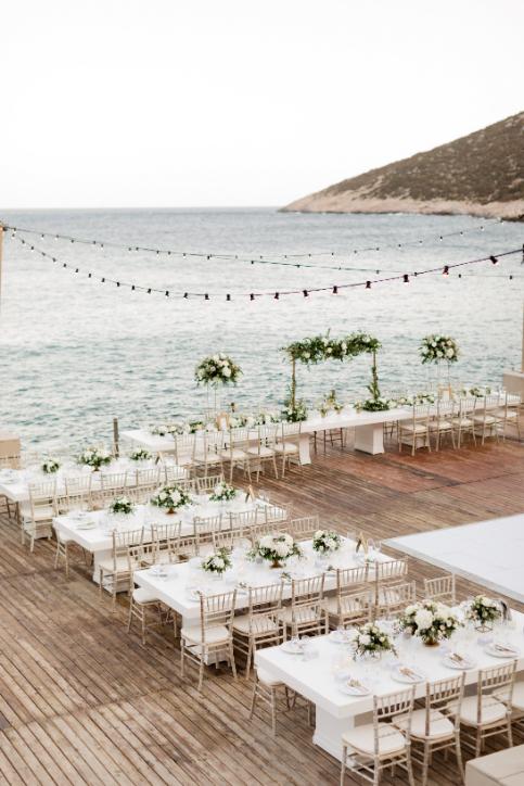 wedding dinner setting in lazarou destination wedding in sifnos island greece by think happy events