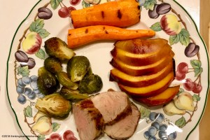 grilled pork and peaches on the plate