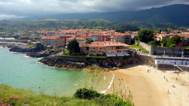 The pretty cove of Sablon, in Llanes, is packed with locals on sunny days