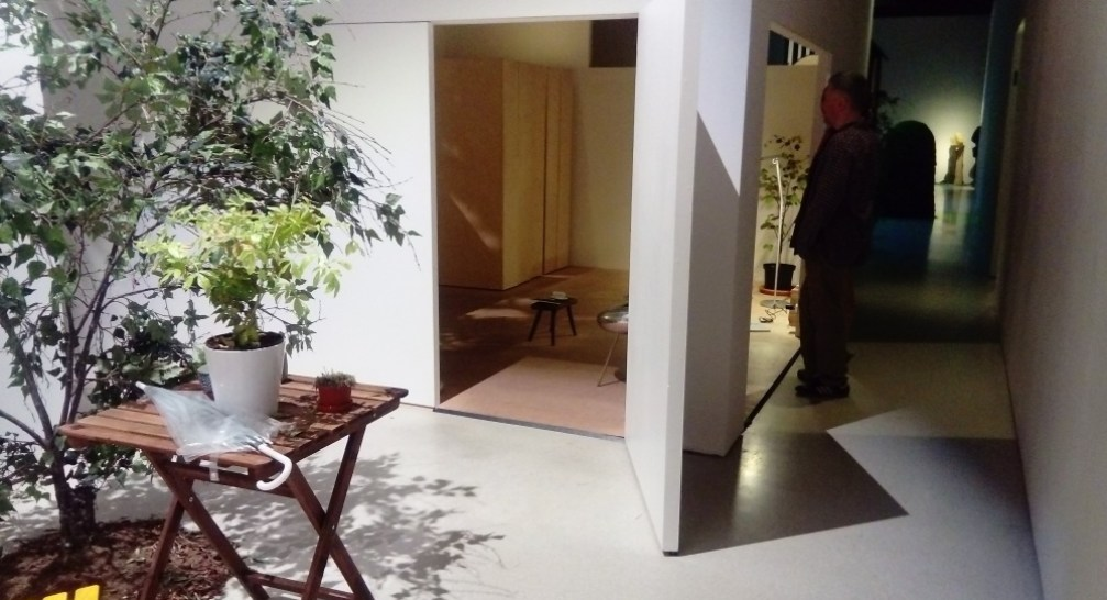 The house as white boxes in a network of outdoor functional spaces.