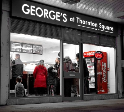 Macclesfield Takeaways illustrated by view at night time of shop front for Georges at Thornton Square