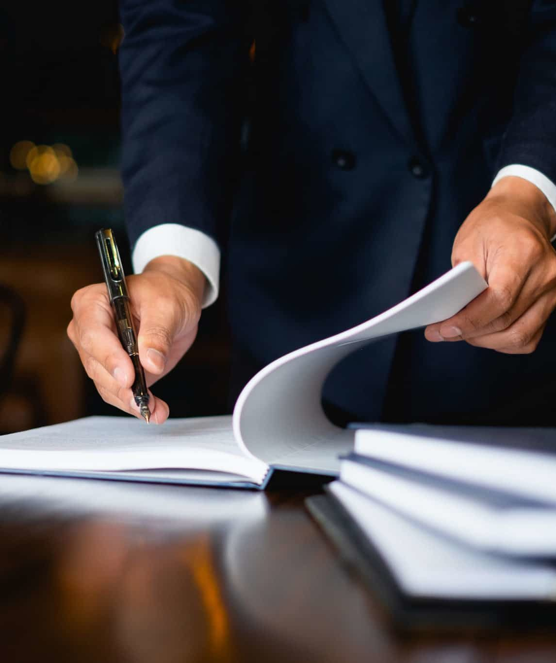 Lawyer_signing_a_document