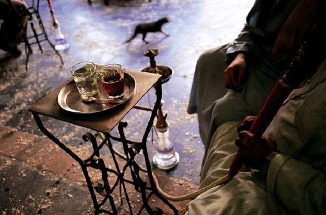 Tea and shisha, a water pipe with flavored tobacco, are standard in Egyptian cafes.  Photograph by Pascal Meunier,