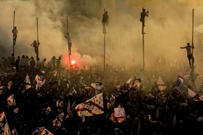 Ultras white Knights- Zamalek football club fans celebrate winning the Egyptian league title with fireworks and flags.