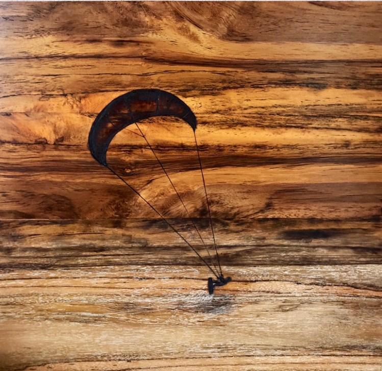 Kitesurfer goes air borne. The sky is ferocious.