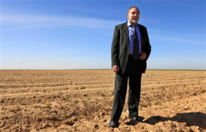 """Israel's new foreign minister, Avigdor Lieberman, stands in a field just outside the Gaza Strip. Lieberman's right-wing Yisrael Beiteinu Party had an impressive showing in Israel's recent election, campaigning with the slogan """"Without loyalty, there is no citizenship."""""""