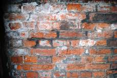 Prisoners used to carve their names in the brick walls (like ancient graffiti)