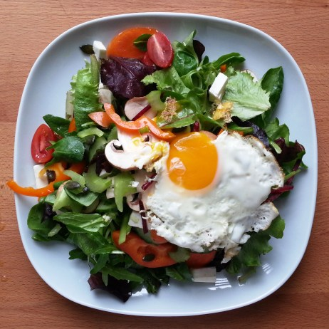 mixed greens salad with fried egg
