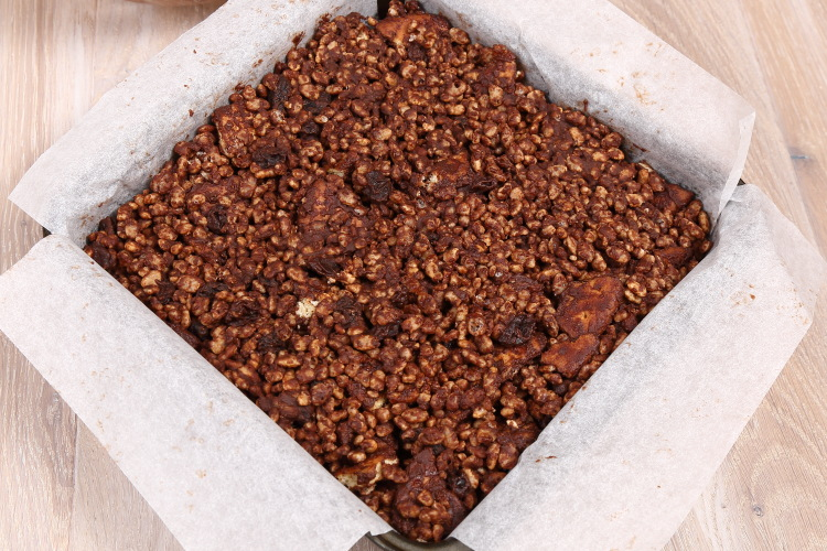 Chocolate tiffin in a square tin lined with baking paper