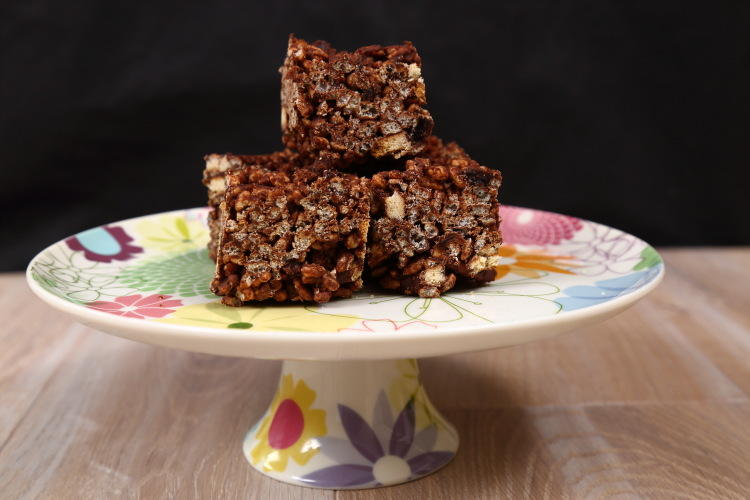 Chocolate Tiffin, chopped into squares and piled up on a pretty spring flowers cake stand