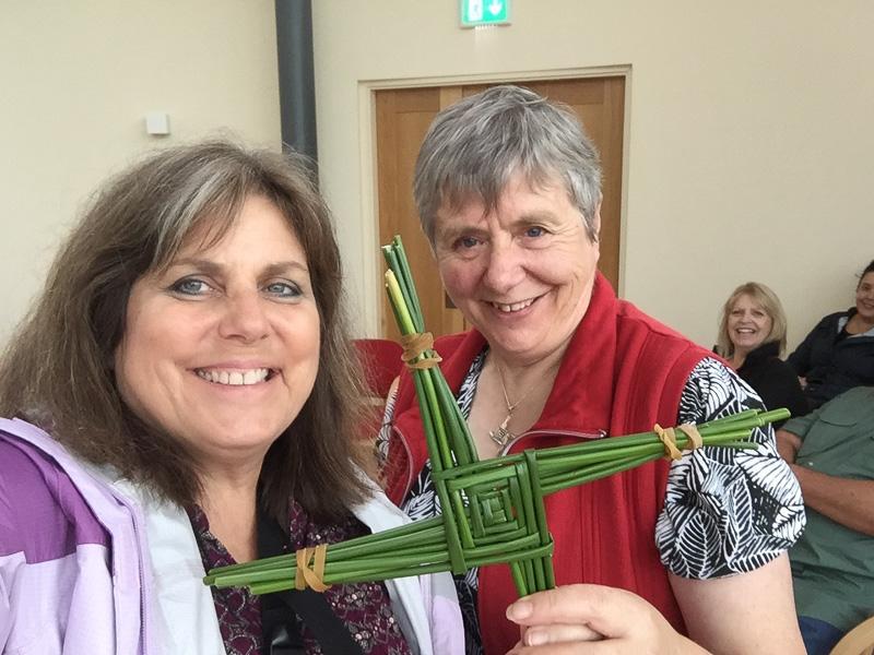 Mindie Burgoyne receives the St. Brigid's Cross from Sr. Phil