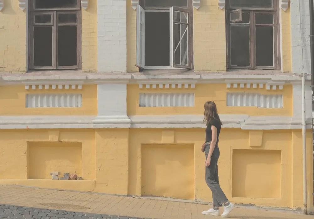 how to unplug - woman walking one sidewalk