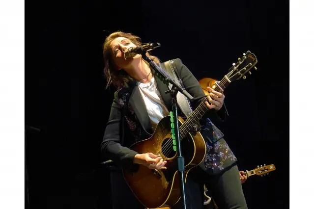 Brandi Carlile leaning into mic 062919