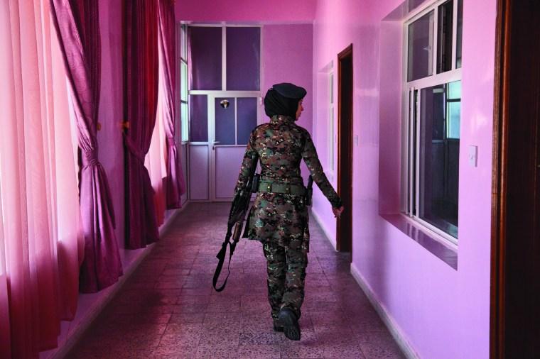 A lieutenant in the elite female counterterrorism unit patrols the women's barracks. Photo Credit: Stephanie Sinclair/National Geographic Women of Vision Exhibit