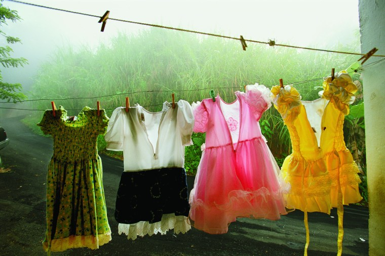AMY TOENSING Dresses festoon a clothesline in Utuado, a lush mountainous region in central Puerto Rico.