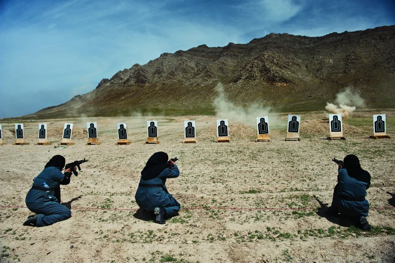 LYNSEY ADDARIO Women—mostly widows—train for police force jobs at a firing range near Kabul.