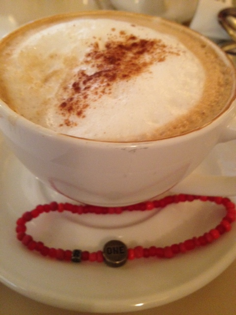 Coffee with the women from RED and our RED bracelets.