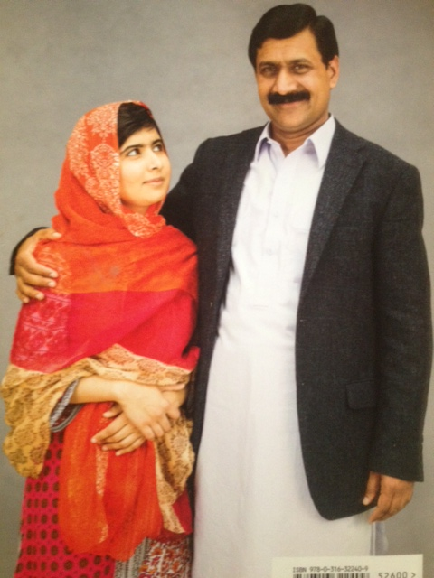 "Photo of Malala and her father on the back cover of her new book ""I am Malala""."