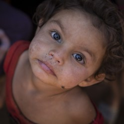 Rami*, two, at her home in a tented refugee settlement in Lebanon, near the Syrian border. *All names have been changed to protect identities. Photo Credit: Jonathan Hyams/Save the Children